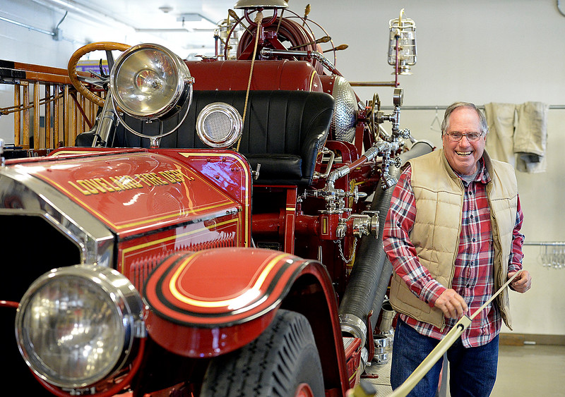 Fran Lyons, a longtime former Loveland firefighter, shows off an antique 1925 American LaFrance firetruck Tuesday, Dec. 5, 2017, at Loveland Fire Rescue Authority station 1 in downtown Loveland. In addition to their collection of antique trucks, they recently purchased a 1952 hand-built ladder firetruck that used to be in service in Loveland.  (Photo by Jenny Sparks/Loveland Reporter-Herald)