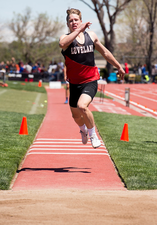 . Loveland\'s Zach Weinmaster throws a triple jump in the finals Saturday May 20, 2017 during the 2017 CHSAA State Track Championships at Jeffco Stadium in Lakewood. (Michael Brian/For the Reporter-Herald)