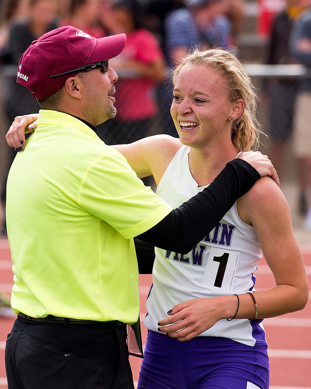 . Mountain View\'s Lauren Offerman receives congratulations from her former track coach, and current Loveland High School Athletic Director, Kevin Clark after her championship win in the 4A Girls 1600-meter finals Sunday afternoon May 21, 2017 during the CHSAA State Track and Field Meet at Jeffco Stadium in Lakewood. (Michael Brian/For the Reporter-Herald)
