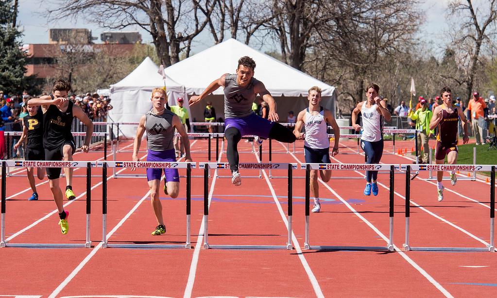 . Mountain View\'s Nolan Kembel, center, flies over the final hurdle as he heads to a State Championship in the 4A Boys 300-meter hurdles Saturday afternoon May 20, 2017 at Jeffco Stadium in Lakewood. (Michael Brian/For the Reporter-Herald)