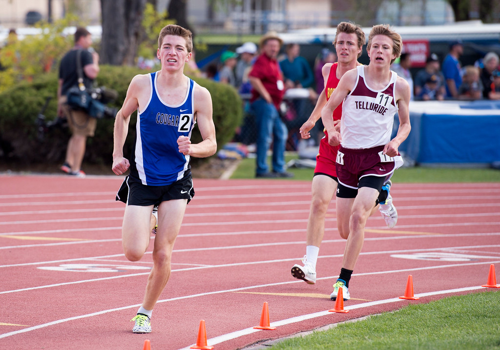 . Resurrection Christian\'s Christian Fagerlind, left, rounds the track in the 2A Boys 1600-meter final Sunday afternoon May 21, 2017 during the CHSAA State Track and Field Meet at Jeffco Stadium in Lakewood. (Michael Brian/For the Reporter-Herald)