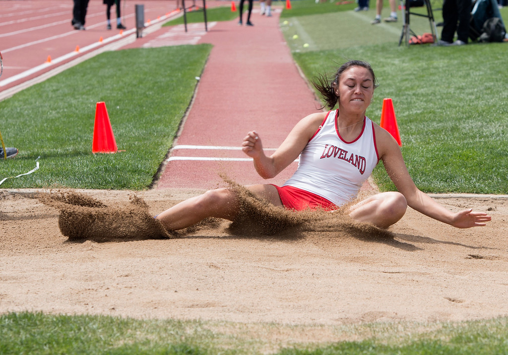 . Loveland\'s Tatum Rembao lands her last attempt in the 5A Girls Long Jump finals Sunday morning May 21, 2017 during the CHSAA State Track and Field Meet at Jeffco Stadium in Lakewood. (Michael Brian/For the Reporter-Herald)