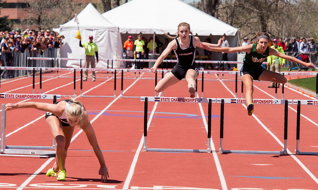 . Loveland\'s Hannah Weinmaster, center, clears the final hurdle in the 5A Girls 300-meter finals Saturday afternoon May 20, 2017 during the 2017 CHSAA State Track Championships at Jeffco Stadium in Lakewood. (Michael Brian/For the Reporter-Herald)