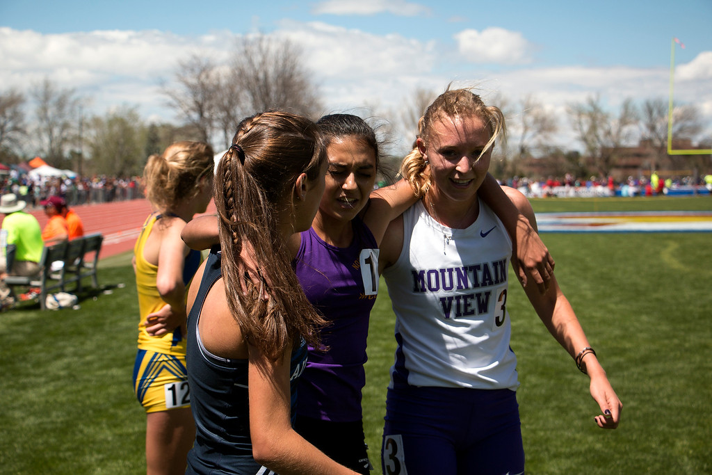 . Three track and Field athletes come together after running in the girl\'s 3200 meter state championship at Jeffco Stadium, Saturday, May 20, 2017. (Michelle Risinger/ Loveland Reporter-Herald)
