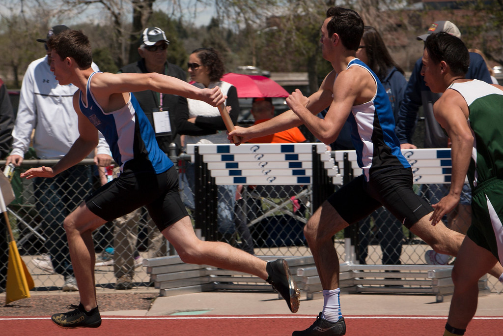 . Resurrection Christian School\'s Colton Stahla hands off the baton to Benjamin Jackson in the 2A 4x200 relay at Jeffco Stadium for the final championship Saturday, May 20, 2017. (Michelle Risinger/ Loveland Reporter-Herald)