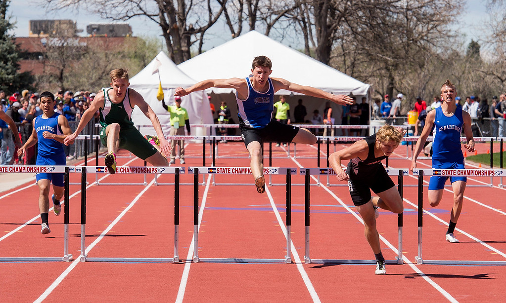 . Resurrection Christian\'s Benjamin Jackson, center, clears the last hurdle as the race leader stumbles during the 3A Boys 300-meter hurdles Saturday afternoon May 20, 2017 at Jeffco Stadium in Lakewood. Jackson edged out his competitors for a State Championship. (Michael Brian/For the Reporter-Herald)