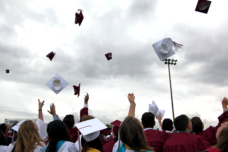 2107 Berthoud High School graduates toss their caps in conclusion to their commencement ceremony on Saturday, May 28th. (Michelle Risinger/ Loveland Reporter-Herald)