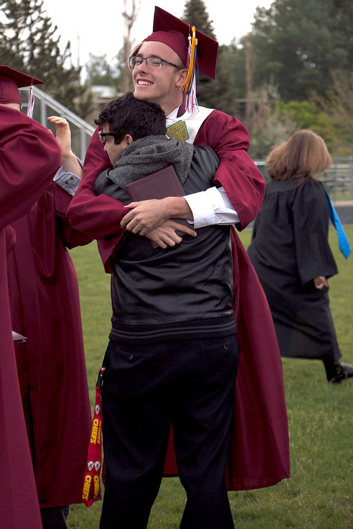 . Ben Krueger hugs one of his peers in celebration of receiving his diploma at the Berthoud High School graduation, Saturday, May 28, 2017. (Michelle Risinger/ Loveland Reporter-Herald)