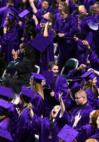 Mountain View High School graduates, including Kenzie Anderson, throw their caps in the air during their commencement ceremony Saturday, May 27, 2017, at the Budweiser Event Center in Loveland. (Photo by Jenny Sparks/Loveland Reporter-Herald)