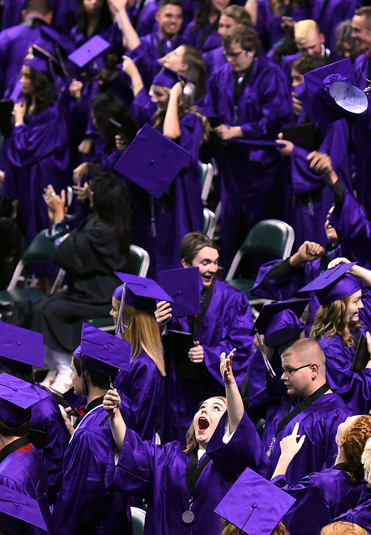 . Mountain View High School graduates, including Kenzie Anderson, throw their caps in the air during their commencement ceremony Saturday, May 27, 2017, at the Budweiser Event Center in Loveland. (Photo by Jenny Sparks/Loveland Reporter-Herald)