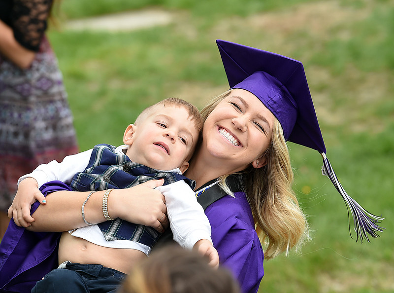 Mountain View High School graduate Rebecca Reynolds hugs her little brother, Sklar Reynolds, 3, after her commencement ceremony Saturday, May 27, 2017, at the Budweiser Event Center in Loveland. (Photo by Jenny Sparks/Loveland Reporter-Herald)