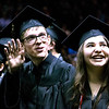 Jace Williams, left, and Elaina Vick, right, take their seats at the Thompson Valley High School graduation at the Budweiser Events Center on Saturday, May 28, 2017. (Michelle Risinger/ Loveland Reporter-Herald)