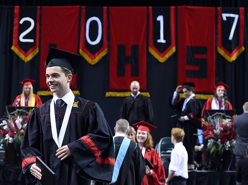 Loveland High School graduate Noah Kline is all smiles after collecting his diploma during his commencement ceremony Saturday, May 27, 2017, at the Budweiser Event Center in Loveland. (Photo by Jenny Sparks/Loveland Reporter-Herald)