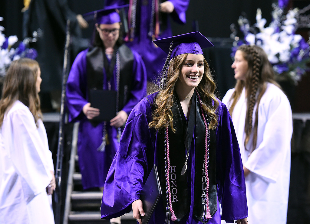 . Mountain View High School graduate and Miss Loveland Valentine 2017 McKenna Dellinger walks back to her seat after getting her diploma diploma during her commencement ceremony Saturday, May 27, 2017, at the Budweiser Event Center in Loveland. (Photo by Jenny Sparks/Loveland Reporter-Herald)