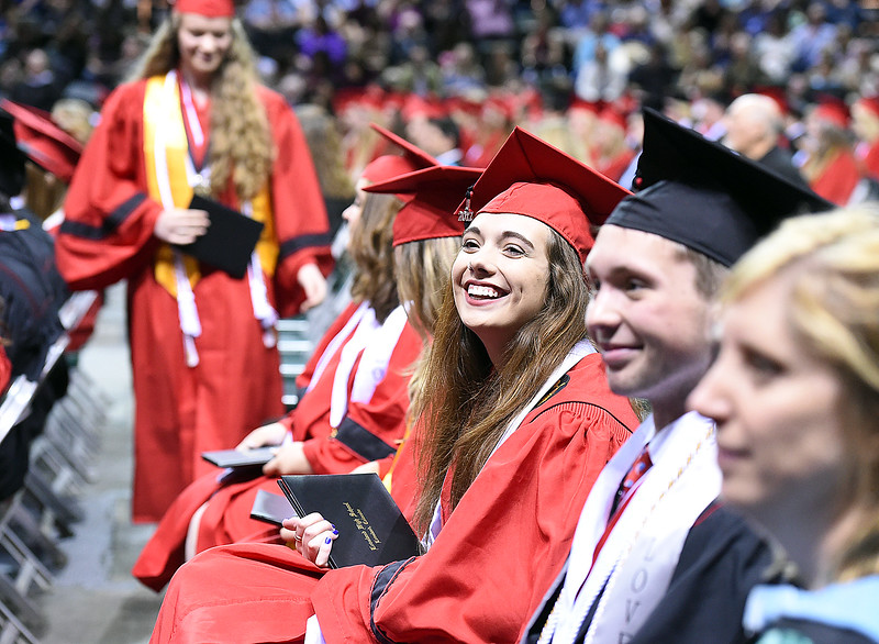 Loveland High School graduate Lillian Bishop Koso smiles at family and friends after getting her diploma during her commencement ceremony Saturday, May 27, 2017, at the Budweiser Event Center in Loveland. (Photo by Jenny Sparks/Loveland Reporter-Herald)
