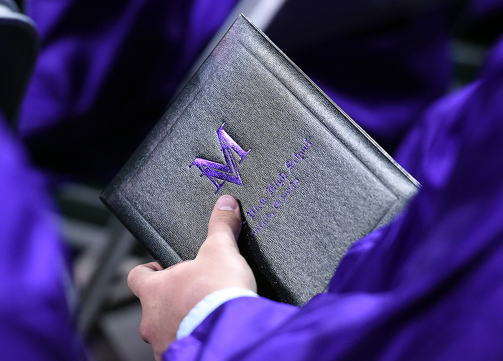 . A Mountain View High School graduate holds his diploma during his commencement ceremony Saturday, May 27, 2017, at the Budweiser Event Center in Loveland. (Photo by Jenny Sparks/Loveland Reporter-Herald)