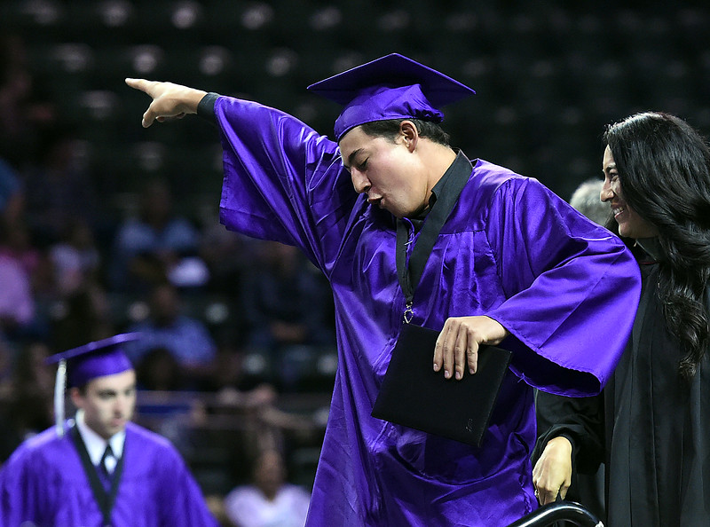 Mountain View High School graduate Tyler Harshman reacts after getting his diploma during his commencement ceremony Saturday, May 27, 2017, at the Budweiser Event Center in Loveland. (Photo by Jenny Sparks/Loveland Reporter-Herald)