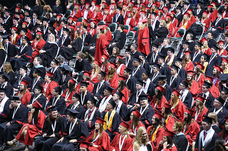 Loveland High School graduates return to their seats after getting their diplomas Saturday, May 27, 2017, at the Budweiser Event Center in Loveland. (Photo by Jenny Sparks/Loveland Reporter-Herald)