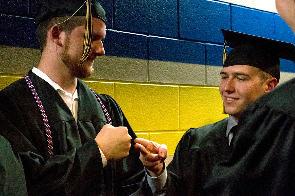 . Blake Leben, left, and Kyle Morgan, right, play rock-paper-scissors as they wait to line up for the Thompson Valley High School graduation ceremony at the Budweiser Events Center on Saturday, May 28, 2017. (Michelle Risinger/ Loveland Reporter-Herald)