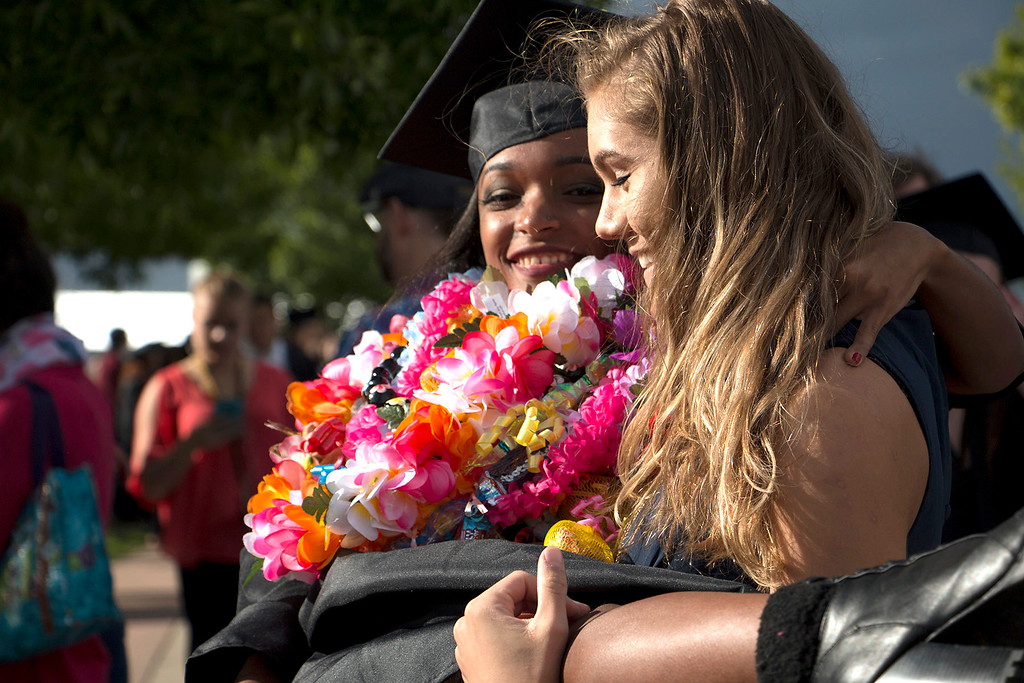 . Brianah Campbell, left, is hoisted up after receiving her diploma from Thompson Valley High School at the Budweiser Events Center on Saturday, May 28, 2017. (Michelle Risinger/ Loveland Reporter-Herald)