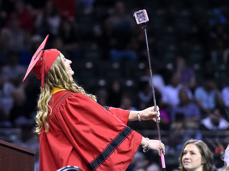 "Loveland High School graduate Addison Woodard takes her first ""adult group selfie"" whiel giving the senior address during her commencement ceremony Saturday, May 27, 2017, at the Budweiser Event Center in Loveland. (Photo by Jenny Sparks/Loveland Reporter-Herald)"
