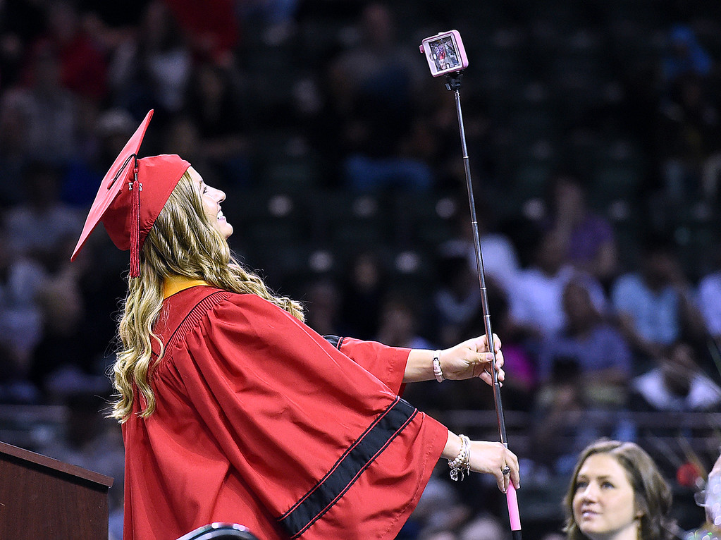 """. Loveland High School graduate Addison Woodard takes her first \""""adult group selfie\"""" whiel giving the senior address during her commencement ceremony Saturday, May 27, 2017, at the Budweiser Event Center in Loveland. (Photo by Jenny Sparks/Loveland Reporter-Herald)"""