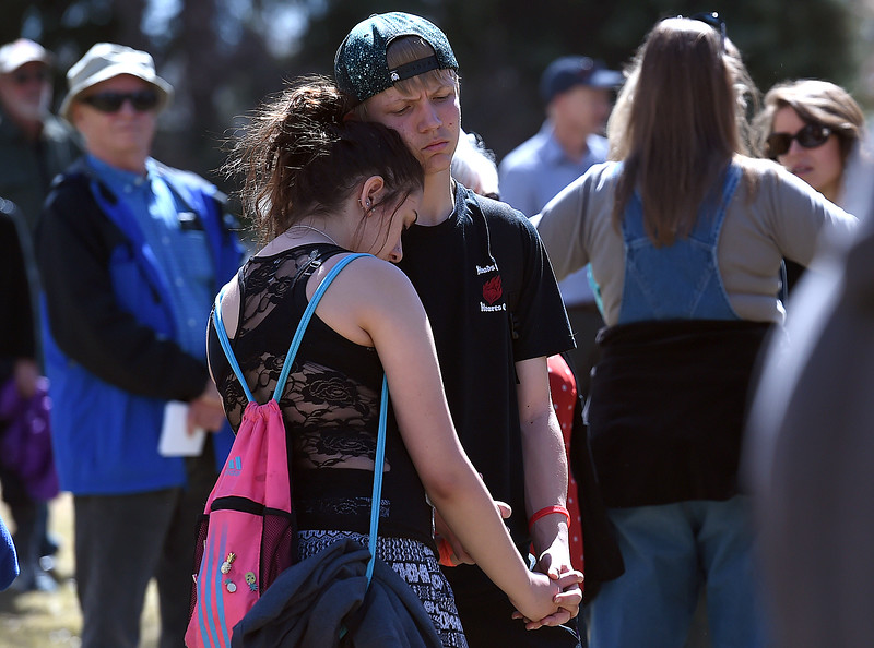 Loveland High School students Anna Perea, 15, and Cody Enders, 14, share in a moment of silence Friday, March 23, 2018, in honor of the Marjory Stoneman Douglas students killed during a rally at Dwayne Webster Veterans Park in Loveland to show their solidarity with the students of Parkland, Florida, and to make a statement about safety in schools. (Photo by Jenny Sparks/Loveland Reporter-Herald)