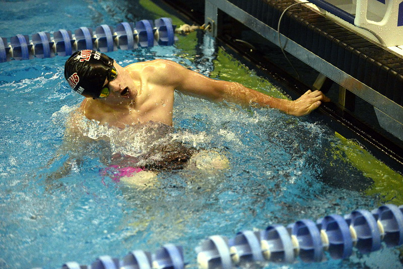 Loveland's Danny Turner makes his barrell turn from backstroke to breaststroke during his heat of the 200-yard individual medley during the 4A state swimming preliminaries on Friday at the  Air Force Natatorium. Turner qualified 12th to reach Saturday's consolation finals.  (Photo by Mike Brohard/Loveland Reporter-Herald)
