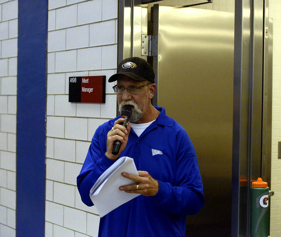 Mark Moss was a familiar vocie for local fans at the 4A state swim meet, as he announces Loveland Swim Club and Thompson Valley athletic events.  (Photo by Mike Brohard/Loveland Reporter-Herald)