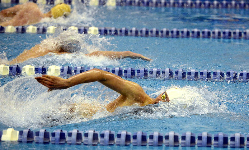 Thompson Valley's Liam Gately surges out in front during the 200-yard freestyle during Saturday's finals of the 4A State Swimming Championships at the Air Force Natatorium. Gately set the classification record with an All-American time of 1:36.94, also breaking a city record that had stood for 20 years.