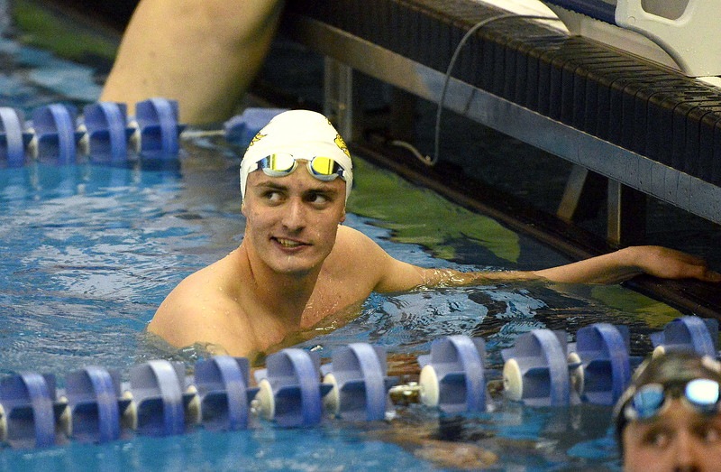 Liam Gately of Thompson Valley cracks a bit of a smile after checking the board at the end of the 200-yard freestyle during Saturday's finals of the 4A State Swimming Championships at the Air Force Natatorium. What he saw was an winning, All-American time that broke the classification record, as well as a 20-year old city record in the event.