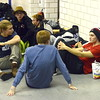 Loveland swimmers rest after warmup at Friday's 4A state swimming preliminaries at the Air Force Natatorium.  (Photo by Mike Brohard/Loveland Reporter-Herald)