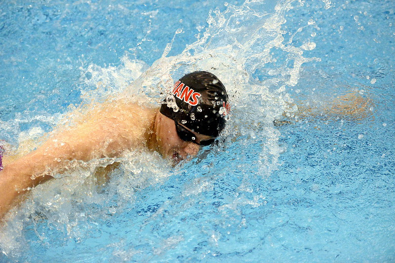 Caden Denton digs in during the anchor leg of the 200-yard freestyle relay during Friday's preliminary session of the 4A state meet at the Air Force Natatorium. The indians' quad moved up and qualified for Saturday's consolation final, and a few events later, Denton made it back in the 100 breaststroke. (Photo by Mike Brohard/Loveland Reporter-Herald)
