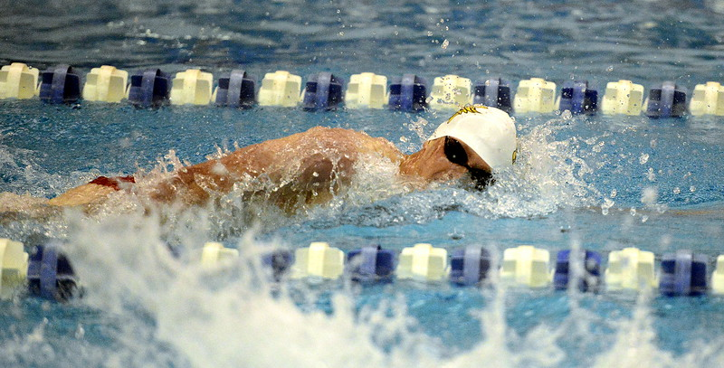 Thompson Valley's Chris Eddy comes back for Saturday's finals in the 200-yard freestyle seeded seventh after posting a time of 1:44.84 during Friday's preliminaries of the 4A state swim meet at the Air Force Natatorium.  (Photo by Mike Brohard/Loveland Reporter-Herald)
