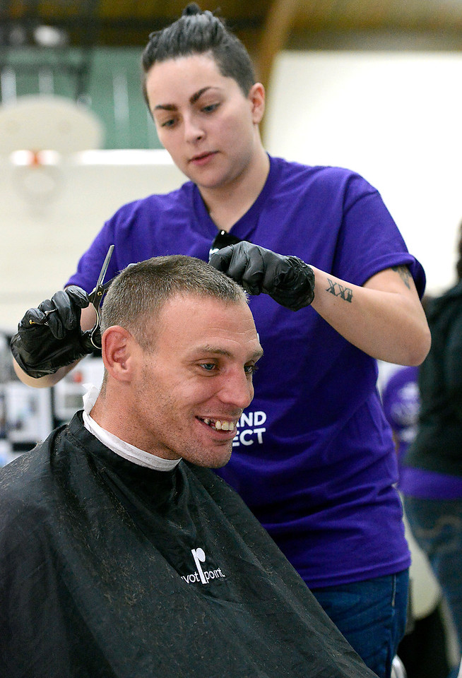 Jeff Dinwiddie smiles as Crystal Cordova cuts his hair Friday, Oct. 14, 2016, during the Loveland Connect event at Truscott Elementary School in downtown Loveland. Students from Hair Dynamics Education Center volunteered their time to give haircuts during the event designed to help homeless and near homeless people find services available to them.   (Photo by Jenny Sparks/Loveland Reporter-Herald)