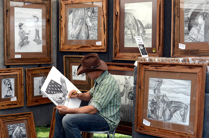 "Glen Powell of Arivaca, Arizona, works on a pencil drawing titled ""Freedon"" Friday, Aug. 12, 2016, at his booth during the Loveland Fine Art and Wine Festival outside Loveland High School in Loveland.  (Photo by Jenny Sparks/Loveland Reporter-Herald)"