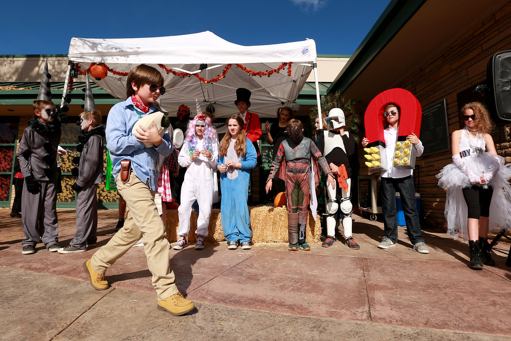 . Graysen Sullivan walks up to his spot during the costume contest for ages 10-12 at the Halloween Family Fun Festival in Loveland, Colo. on Oct. 27, 2018.