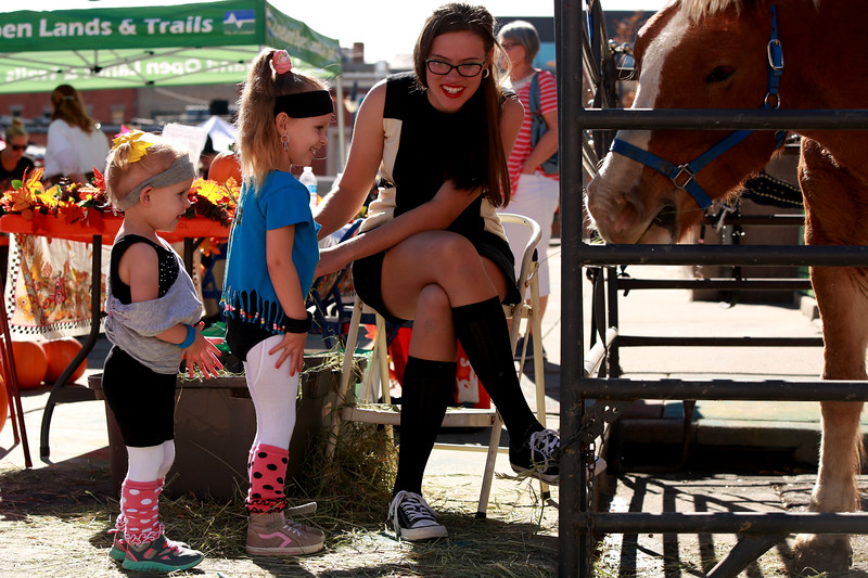Sarah Van Hare shows Allie and Peyton Randolph how to feed Beauty, the horse, at the Halloween Family Fun Festival in Loveland on Oct. 27, 2018.<br /> Photo by Taelyn Livingston/ Loveland Reporter-Herald