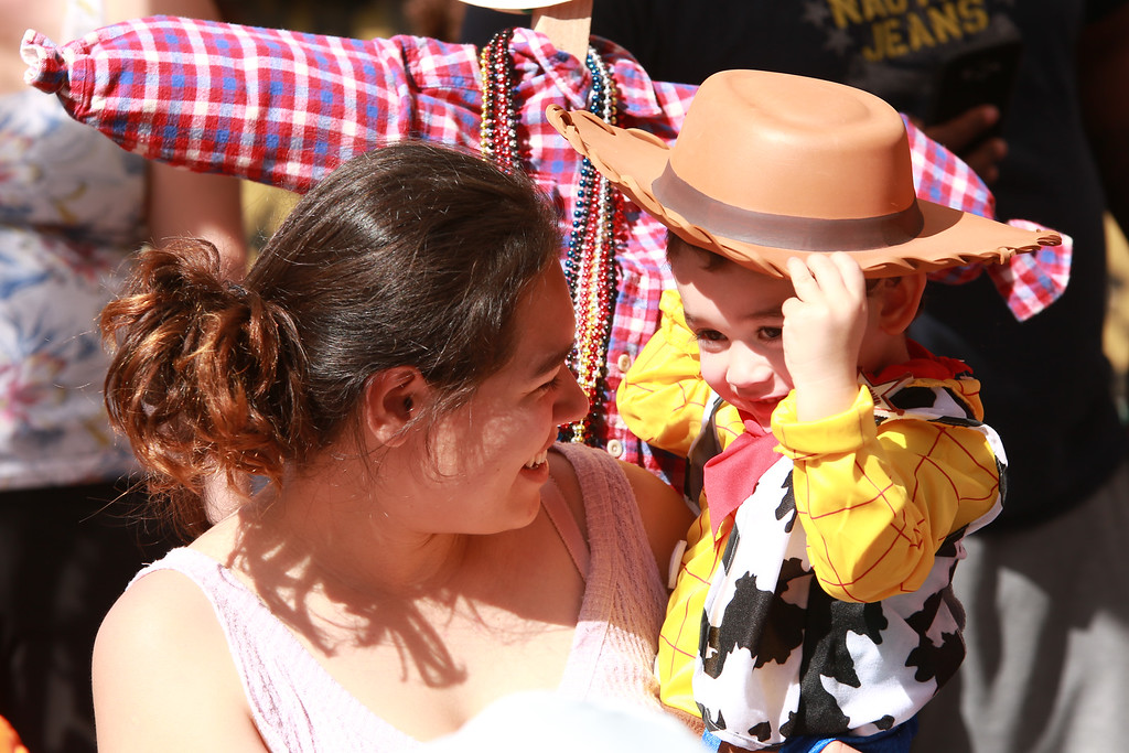 . Marco Valles adjusts his cowboy hat while his mother, Cindy Valles, holds him during the ages 2-3 costume contest at the Halloween Fun Fest in Loveland on Oct. 27, 2018.