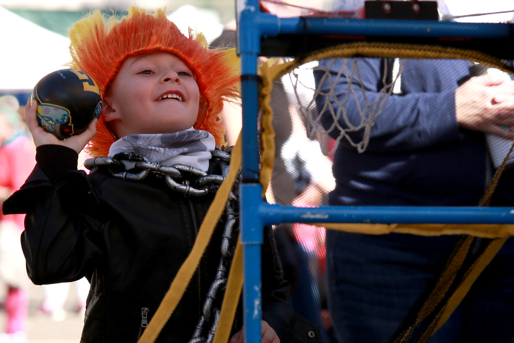 . Jaxon Cummins aims a toy basketball at one of the many games offered for families and attendees of the Halloween Family Fun Festival in Loveland on Oct. 27, 2018. Photo by Taelyn Livingston/ Loveland Reporter-Herald