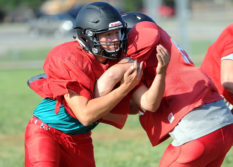 Loveland defensive end Alex Seymour battles an offensive lineman during a recent practice at LHS.