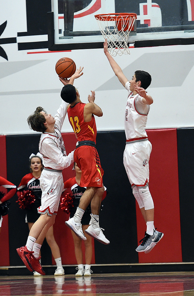 24 2<br /> Loveland High's #Gage Johnson, left, and #2 Avery Rembao try to block a shot by Northglenn's #13 Jaime Gutierrez during their game at Loveland High School on Friday, Dec. 16, 2016. (Photo by Jenny Sparks/Loveland Reporter-Herald)