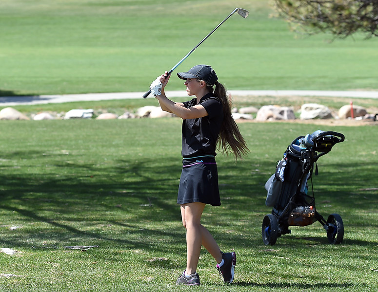 Thompson Valley High's Ryanna Burton hits from the fairway during the Loveland Invitational golf tournament Thursday, April 13. 2017, at the Olde Course in Loveland. (Photo by Jenny Sparks/Loveland Reporter-Herald)