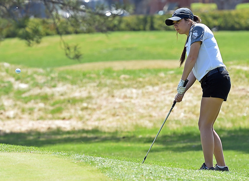 Mountain View High's Deidre Taylor chips her ball onto the green during the Loveland Invitational golf tournament Thursday, April 13. 2017, at the Olde Course in Loveland. (Photo by Jenny Sparks/Loveland Reporter-Herald)