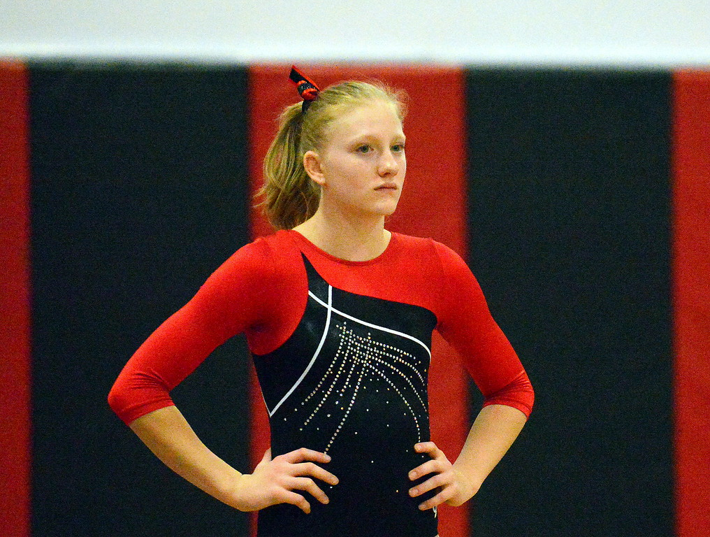 . Loveland\'s Clara Davenport waits for the judge\'s OK before she vaults at the Loveland Invitational gymnastics meet Friday at LHS. (Mike Brohard/Loveland Reporter-Herald)