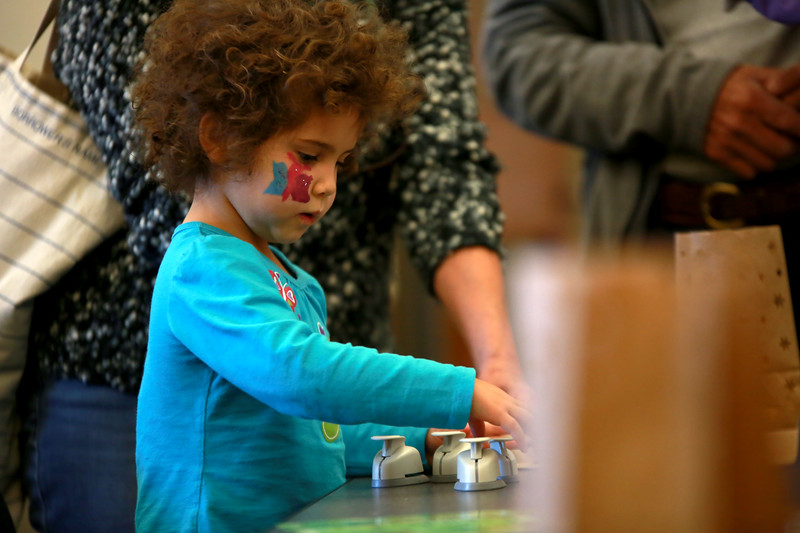 Eliza Renner, 3, makes luminaria a during the Loveland Lights Celebration at the Loveland Public Library on Dec. 8, 2018 in Loveland, Colo. <br /> Photo by Taelyn Livingston/ Loveland Reporter-Herald