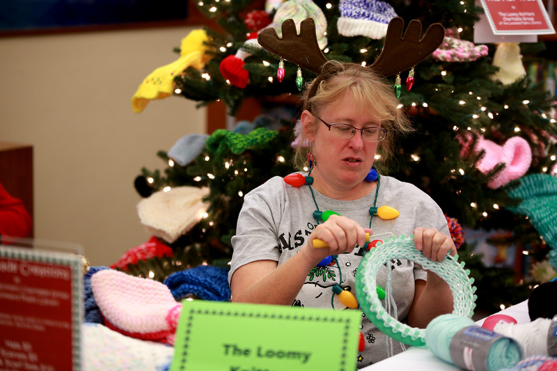 Jennifer Leffler from the Loomy Knitters Charitable Group knits a hat during the Loveland Lights Celebration at the Loveland Public Library on Dec. 8, 2018 in Loveland, Colo. <br /> Photo by Taelyn Livingston/ Loveland Reporter-Herald