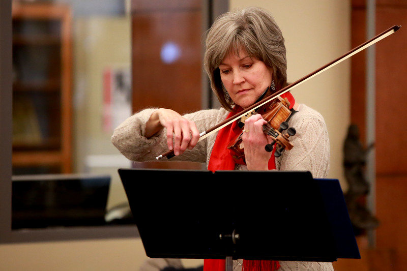 Evelyn Bruxvoort plays the fiddle for a Christamas performance at the Loveland Lights Celebration at the Loveland Public Library on Dec. 8, 2018 in Loveland, Colo.