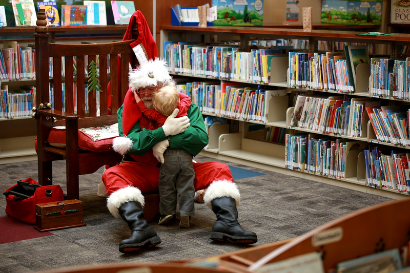 Callen Murawski, 2, gives Santa, also known as Terry Leahy, a big hug during the Loveland Lights Celebration at the Loveland Public Library on Dec. 8, 2018 in Loveland, Colo. <br /> Photo by Taelyn Livingston/ Loveland Reporter-Herald