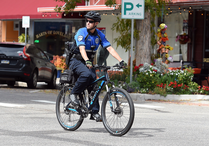 Loveland Police officer Jay Smith patrols Fourth Street on bicycle Friday, Sept. 29, 2017, in downtown Loveland. (Photo by Jenny Sparks/Loveland Reporter-Herald)